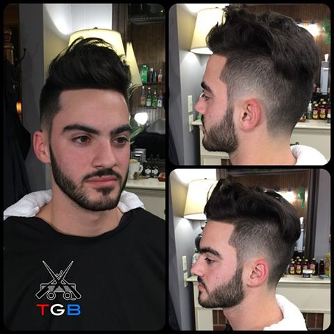 "Here a fantastic cut from our newest barber, Rick, at The Gentlemen's Barber Shop! He expertly crafted for Kyle a Long Fringe Textured haircut with a Disconnected Radial Tapered side and back.  Styled with Layrite Cement.  An amazing cut from an amazing barber.  To book an appointment with Rick or one of our other talented barbers: -Download our free app @ http://thegentlemensbarber.mobapp.at/ -Visit thegentlemensbarber.com and click ""Book an Appointment"" -Click the ""Book Now"" button here on Facebook or through Yelp.  #barber #barbershop #barbering #burstfade #burstfades #fade #taper #rochester #2016 #haircut #hairstyle"