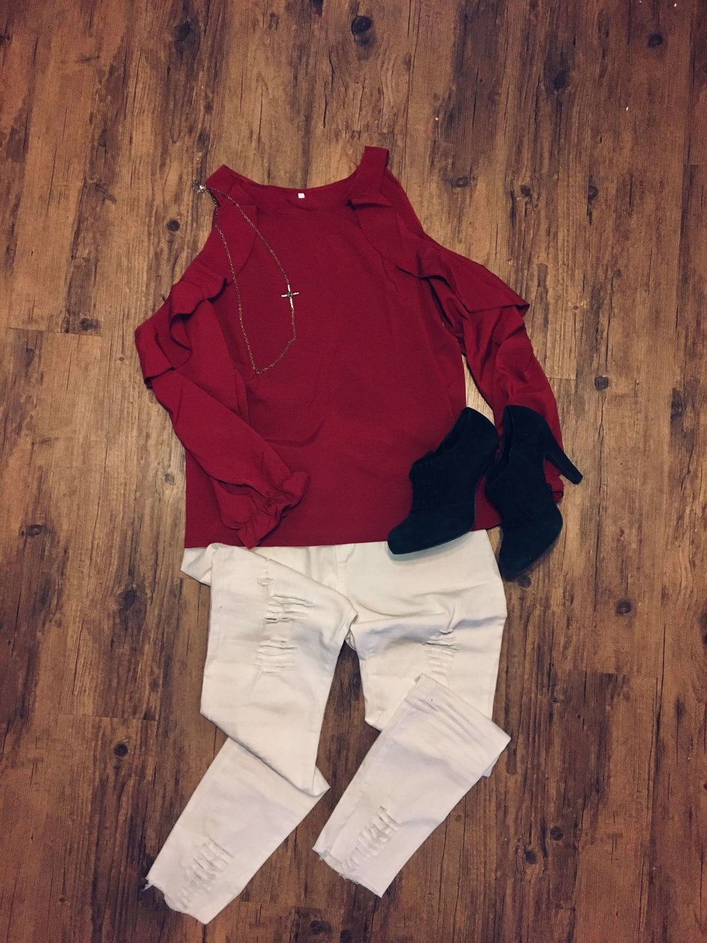 Wine colored cold shoulder top and distressed jeans from Fashom
