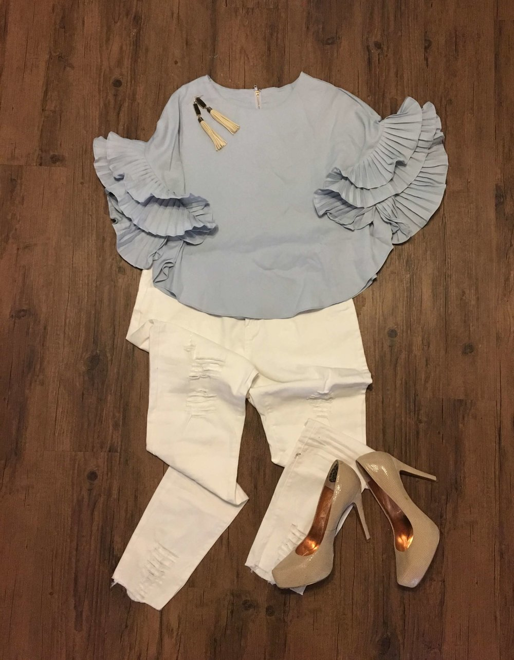 Pale blue top with ruffle sleeves and white distressed jeans from Fashom!