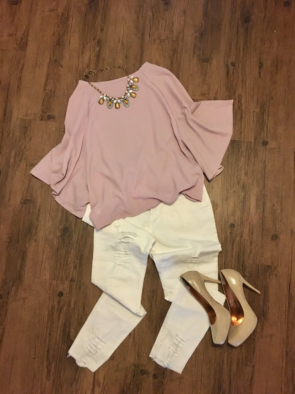 Lavender top with white distressed jeans from Fashom!