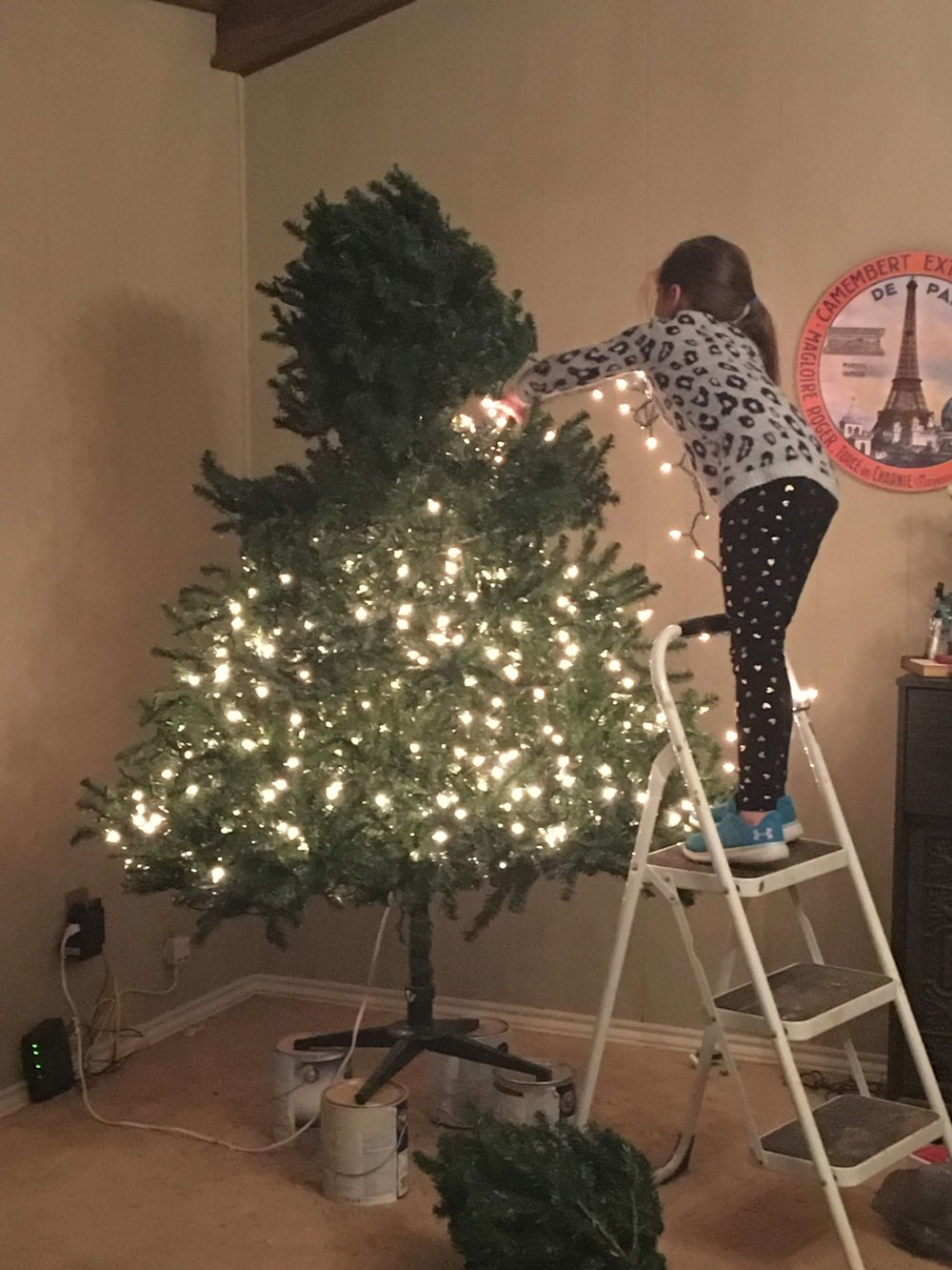 This is the only BEFORE the flocking picture that I had. This is my daughter helping me add lights to the tree.
