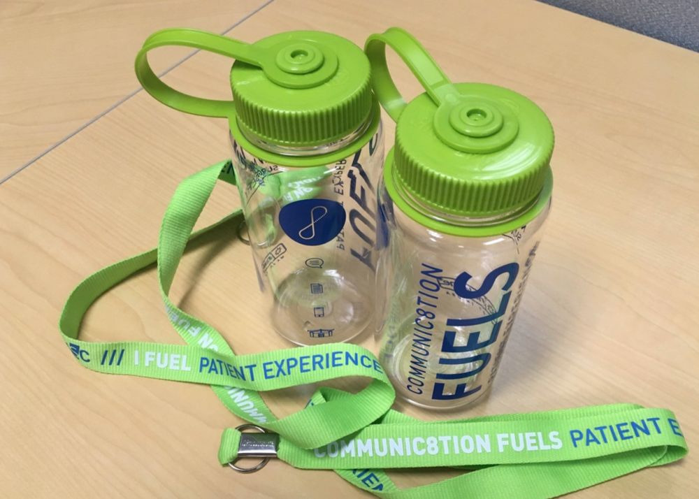 Participants each received a water bottle and lanyard as reminders of the event; lanyards are worn every day by every member of staff, and were designed to start conversations with patients and families.