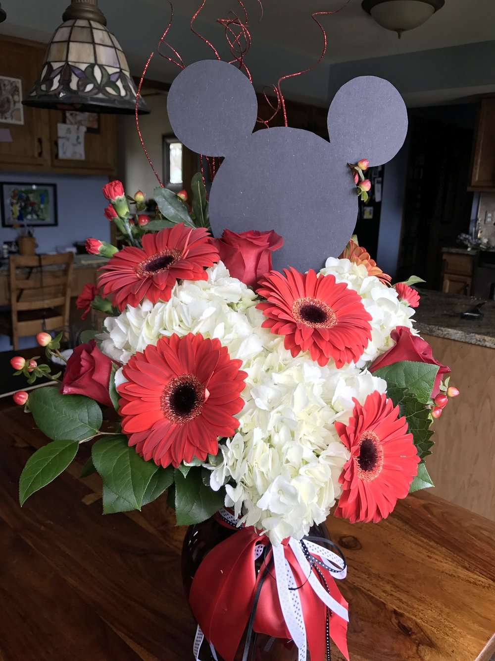 "Flowers from my family- The florist did a great job creating a ""mouse ears"" theme!"