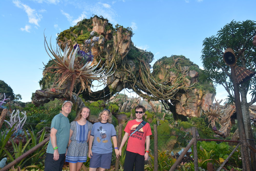 "A group shot of us at Pandora. Ben doesn't love to ""waste time"" with pictures of just scenery! So we have many bad shots of all of us in front of the iconic landmarks of Walt Disney World..."