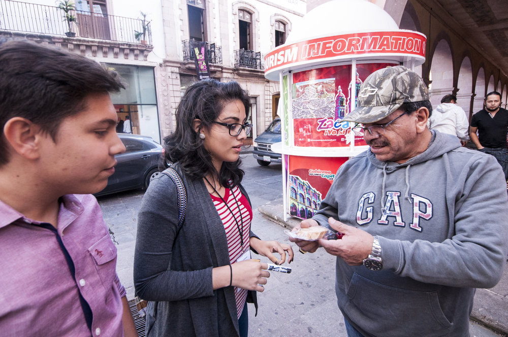 A local man notices what we are doing and tells us his story of how his family started as street vendors and now has a candy company making candy.