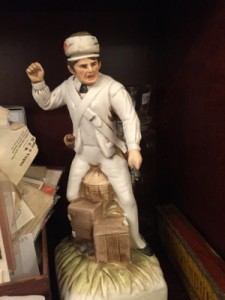 "A collectible statuette available in the 1940s, or around that time, entitled ""Filthy cheese peelers!"""