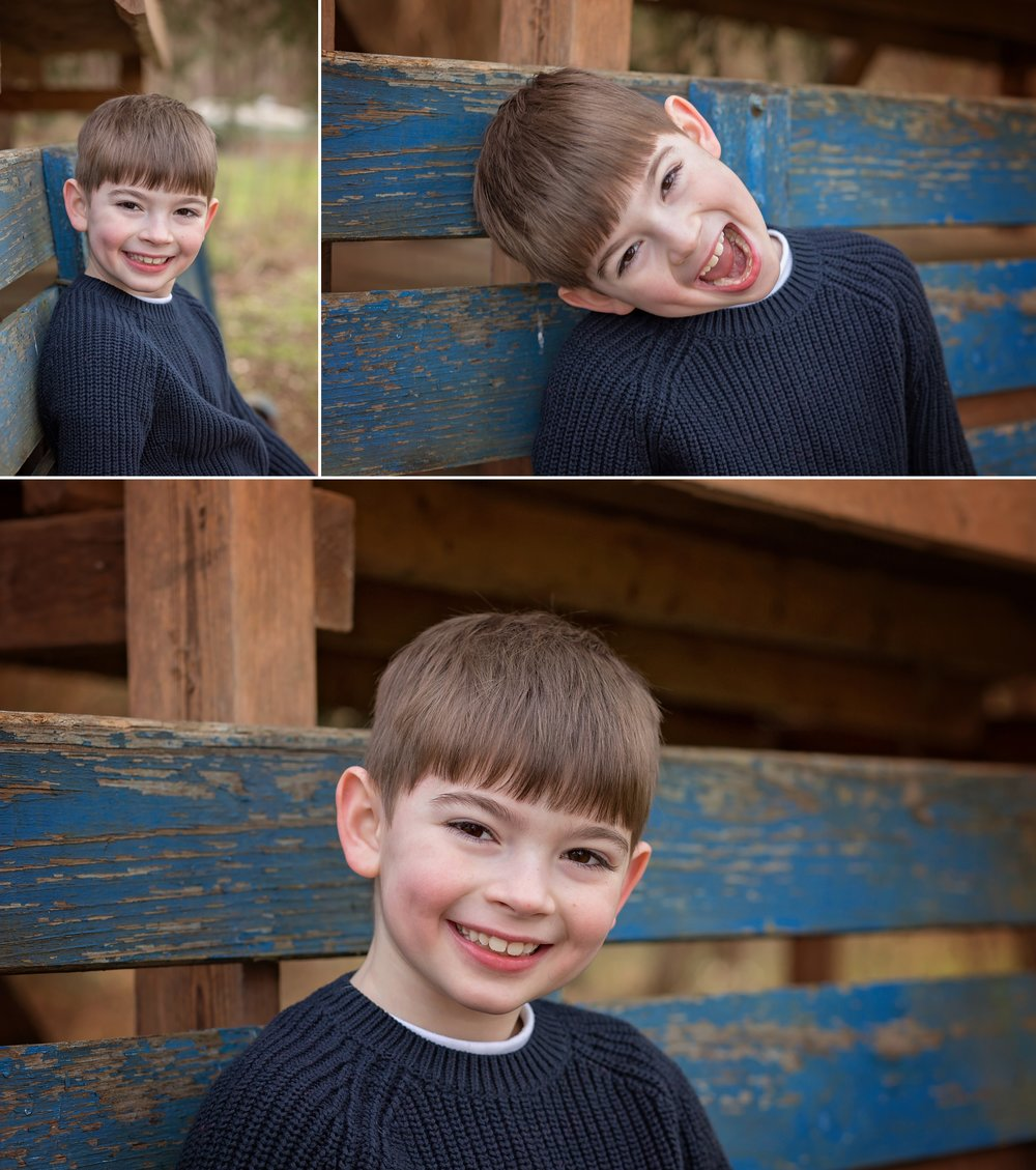 Boy shows off personality smiling for photographer.