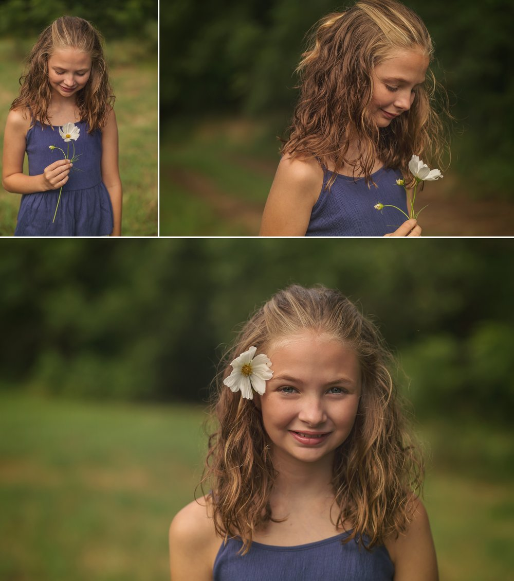 Girl puts flower in hair for photo.