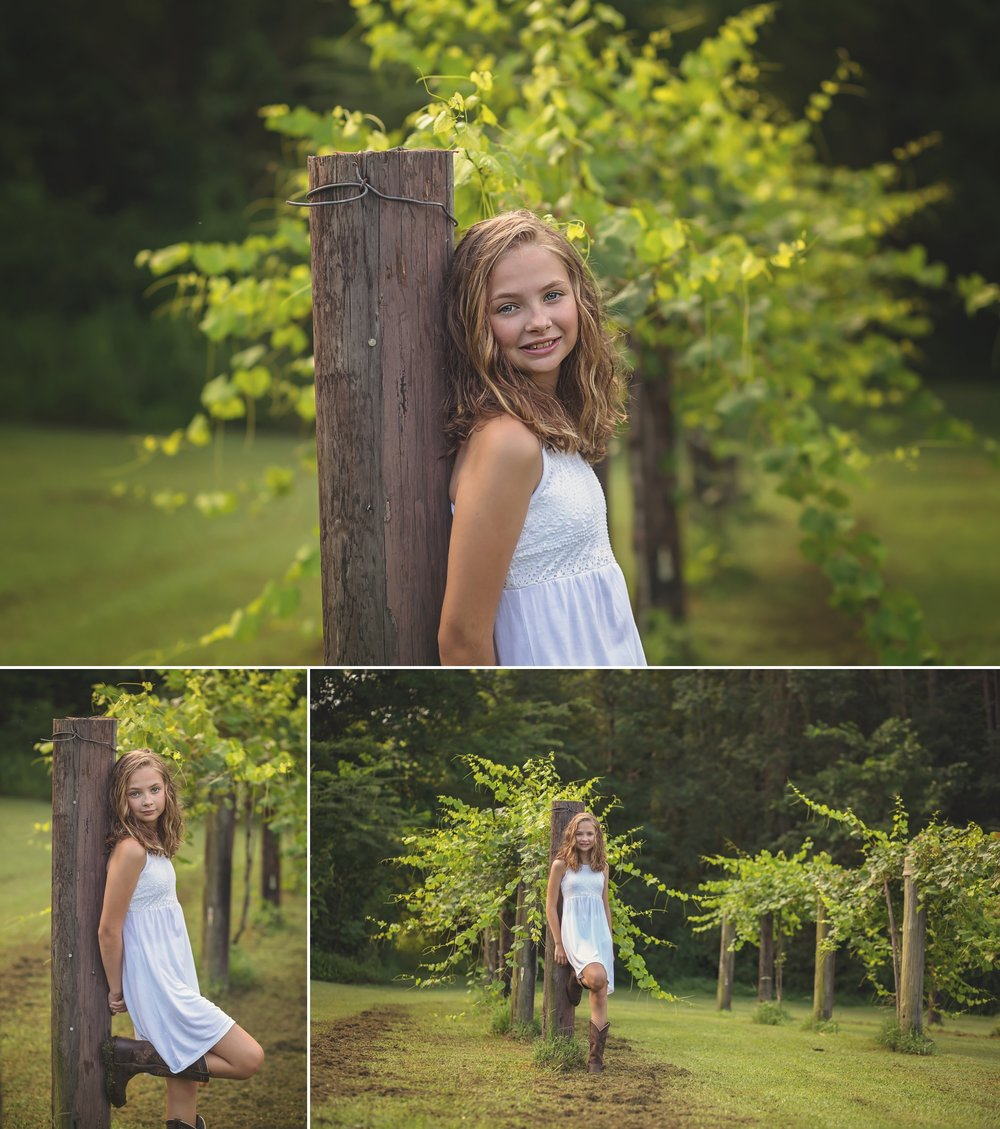 Young girl stands in grape vineyard for child portrait session in Sanford NC.