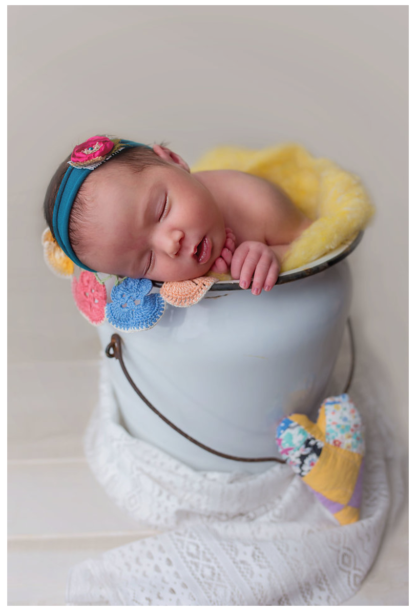 newborn baby in vintage bucket
