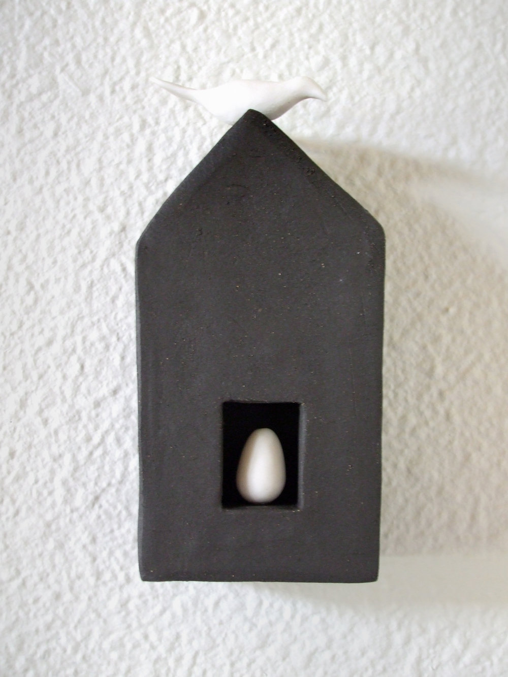 Black House with Egg and Bird
