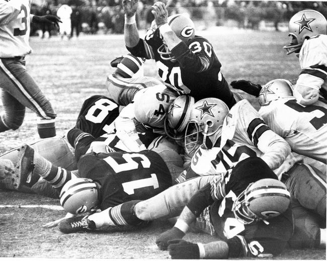 Kramer (number 64, on his side) has just made the block on Jethro Pugh (75) to clear the path for Bart Starr (15) into the end zone, delivering victory for the Packers in the legendary Ice Bowl.