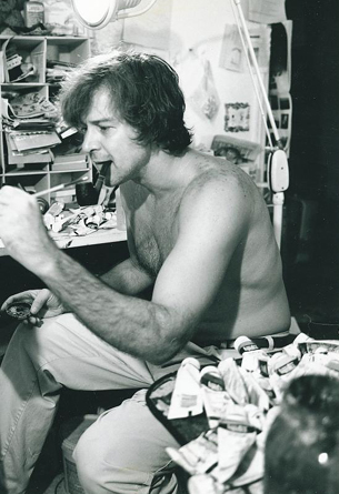 1980's, Willi painting with left hand at at the easel.