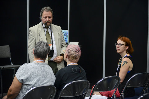 Dr. Jon Stamford presenting his book at the WPC 2016 Book Nook with Sara Riggare in the audience.