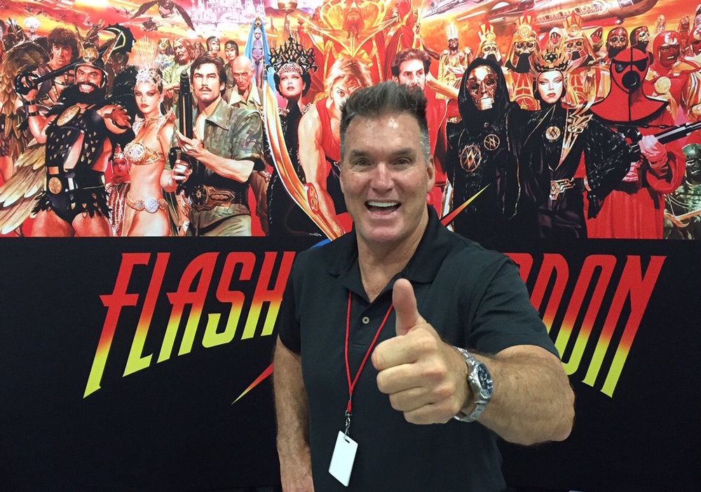 "SAM JONES Sam is best known for his portrayal of Flash Gordon in the 1980 cult classic movie of the same name.  Recently Sam has had cameos as himself in ""Ted"" and its sequel ""Ted 2.""  Films coming out in 2017 with Sam are ""Enter the Fist and the Golden Fleece,"" ""Head Games,"" Axcellerator,"" and the documentary ""Life After Flash."""
