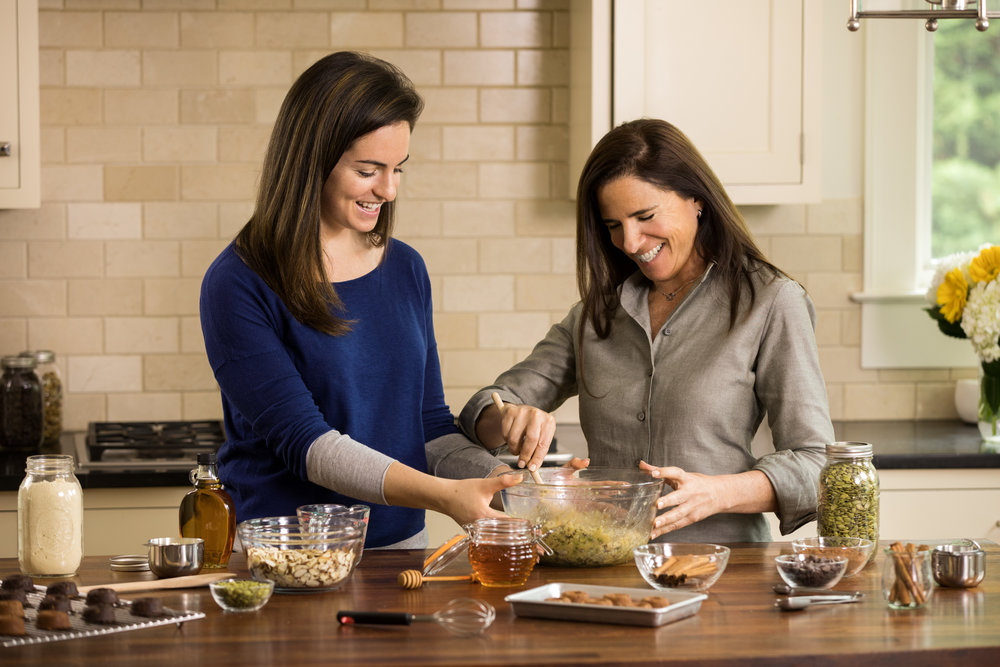 Bridget and Nancy making their 2 Betties healthy donuts in their kitchen.