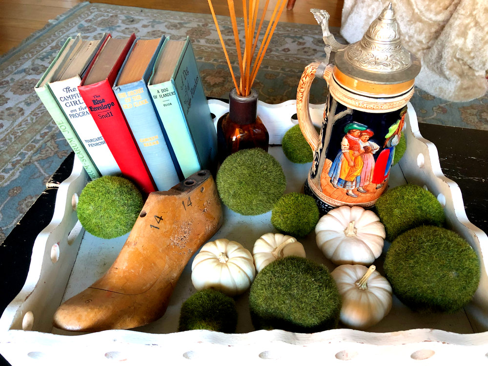 Tabletop beauty: wooden tray - Southern Living Home, old books from neighbor's yard sale, antique shoe mold - a gift from my sister, a German beer stein, green balls from Homegoods, real white pumpkins from Trader Joe's.