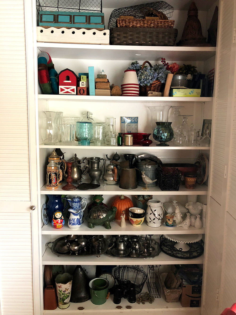 Before you head out to buy more stuff, check your stash of decor items. Taking the time to organize it by material (metal, ceramic, wood) will make choosing items easier.