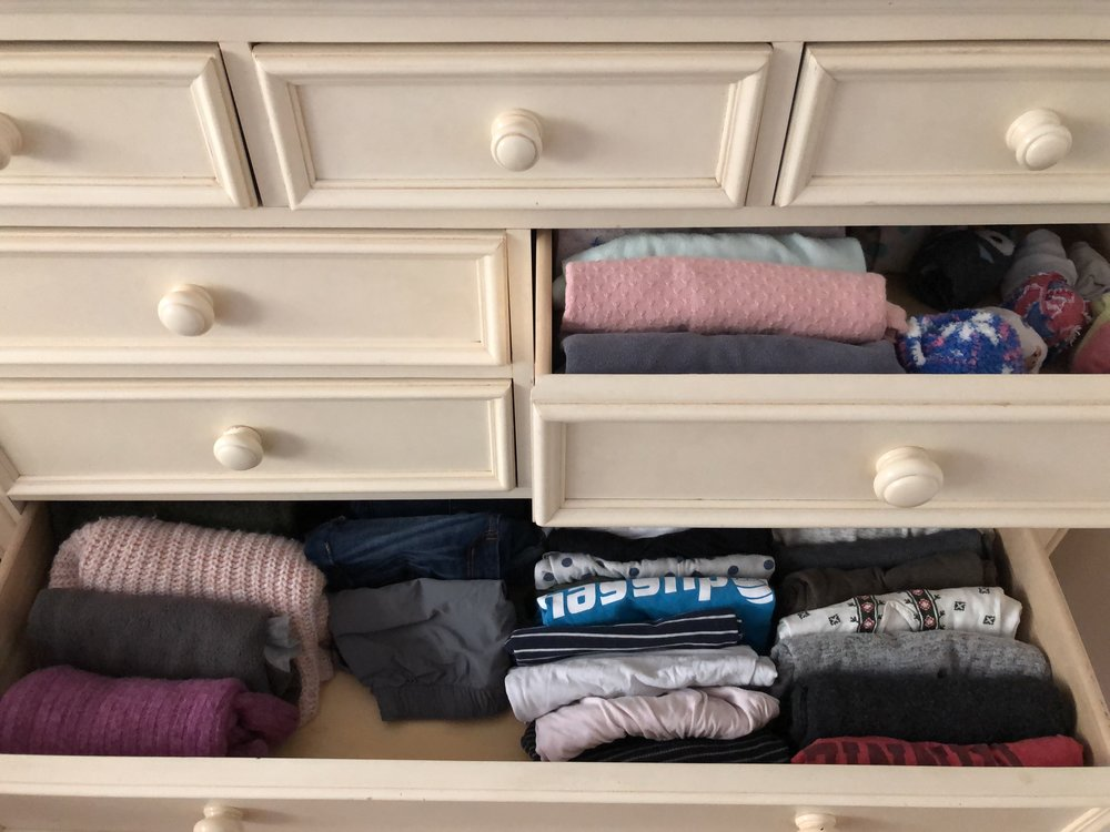 My daughter's drawer after a clean out - when she goes through her clothes, she sees all that she already owns and can share with someone else the items she no longer needs.