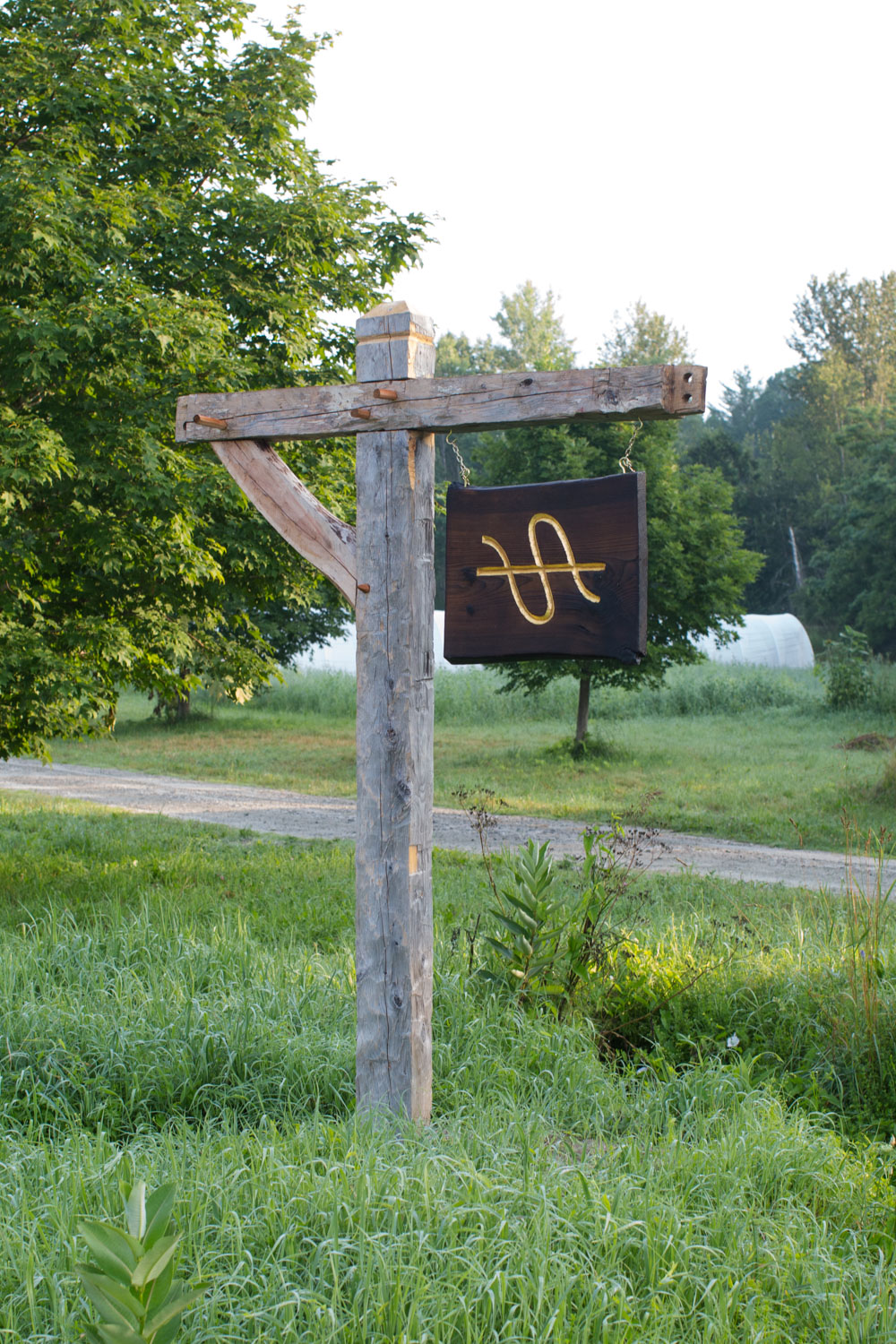 Stitchdown Farm sign hewn gold leaf carved sign
