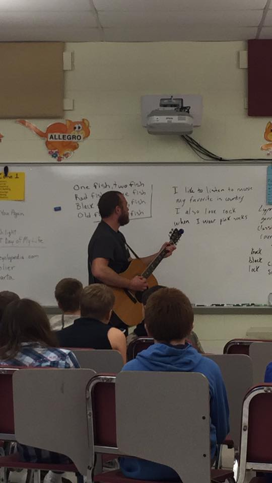 Evan teaching DCS elementary students about songwriting