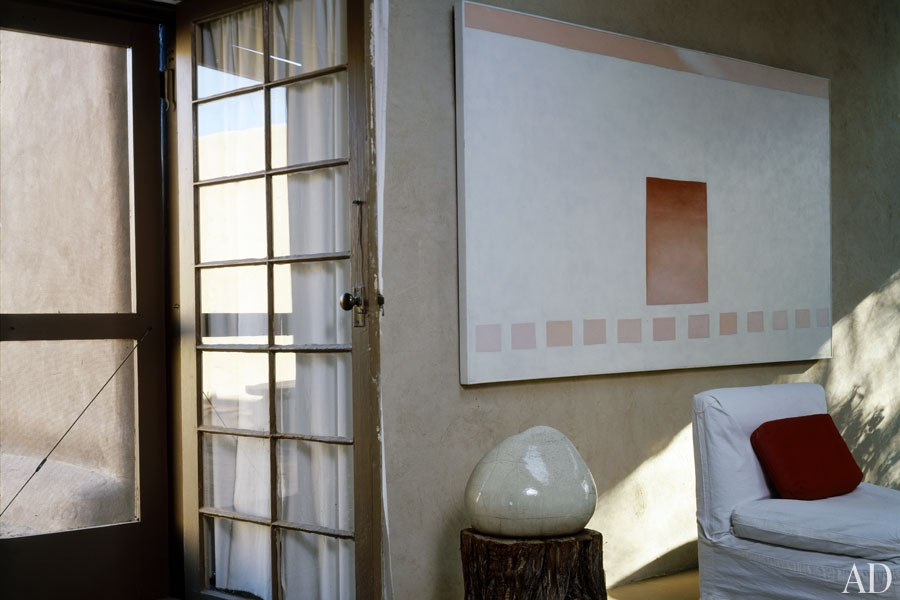 Her painting  White Patio with Red Door , 1960, in the sitting room, one of her many door paintings.