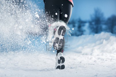 athlete-woman-is-running-during-winter-training-outside-in-cold-snow-weather