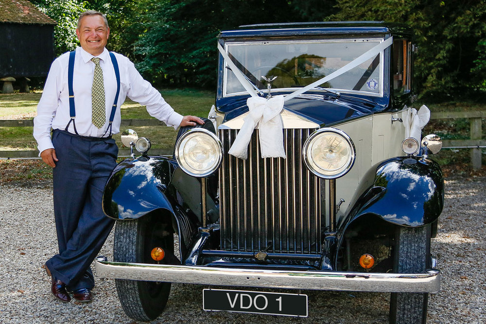 The proud chauffeur with his Rolls-Royce 20/25 limousine