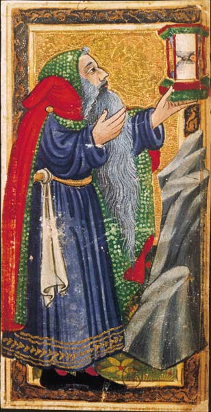 An example of a Hermit tarot card, looking to his lantern. In this example, the lantern also contains time itself (another metric of the sun associated with the card).   Note that the Hermit looks remarkably like Father Christmas, a modern-day herald of the solstice.