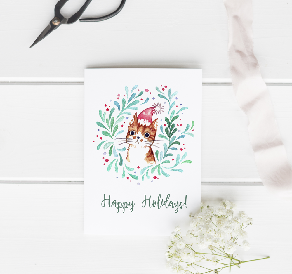 Printable last-minute DIY: Holiday greeting cards. Created with my watercolor cat portrait & mistletoe wreath illustration, this simple printable page can be folded in half for a pretty DIY greeting card.  Also up for the Holidays: Free printable planner stickers and lots of gift tags and stationery