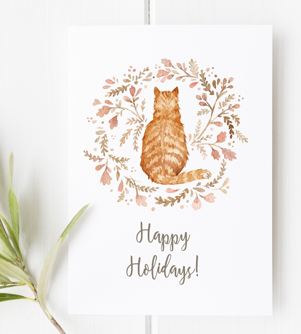 Last-Minute DIY Holiday Greeting Cards: Free Printable! Created with my watercolor cat & wreath illustration, this simple printable page comes with two cards that can be folded in half for a pretty DIY greeting card.  Also up for the Holidays: Free printable planner stickers and lots of gift tags and stationery!