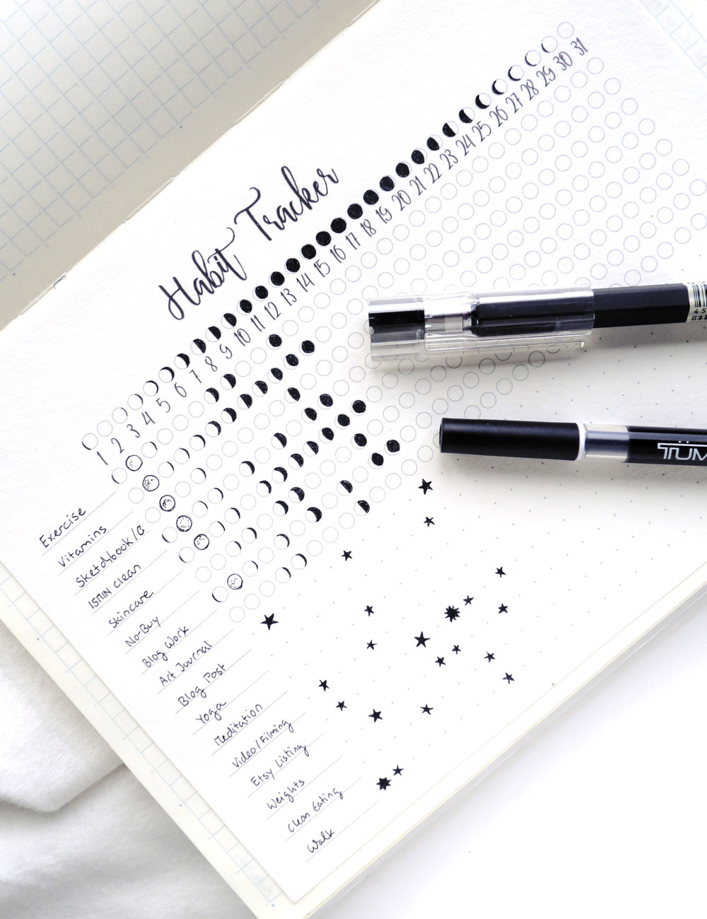My Moon Phases & Stars Habit Tracker printable put to use! I keep track of little personal, health, creativity, and mindfulness related habits with this dual tracking system in my bullet journal.