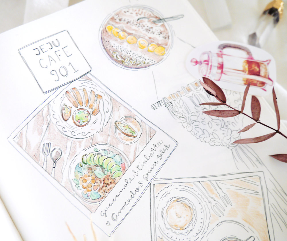 "I sketched in my art journal as I sipped on coffee...  Creative ideas for travel journals, art journaling, doodle diaries... I love adding food drawings whenever I visit a cafe or restaurant! Even a short afternoon trip can feel like a full-on vacation once I document it in my travel sketchbook. Food doodles are simple (you can use the food in front of you as reference or take a quick picture to use later) and add a pinch of deliciousness to any travel diary. :)  The peaceful atmosphere, unique combinations of local ingredients like Deodeok and ""western"" vegan food, the gluten-free and raw options... all in all, Cafe 901 on Jeju Island is a wonderful place to treat yourself, relax, and recharge!"