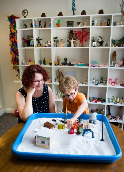 Play therapy, including creative sand tray therapy, holds many benefits for both children and adults.