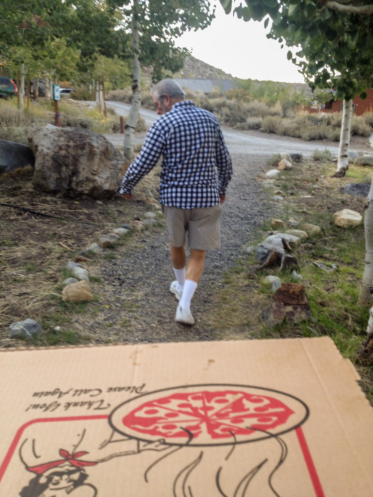Bringing pizza back to the cabin