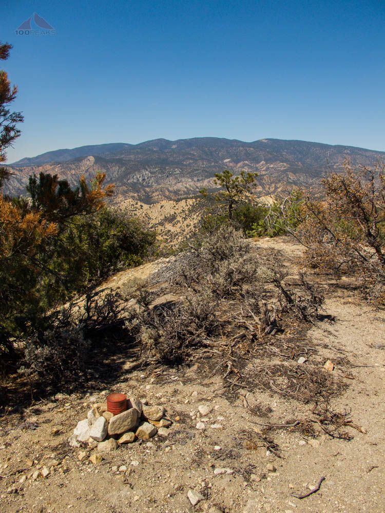 Summit register on San Guilermo Mountain looking towards Mount Pinos