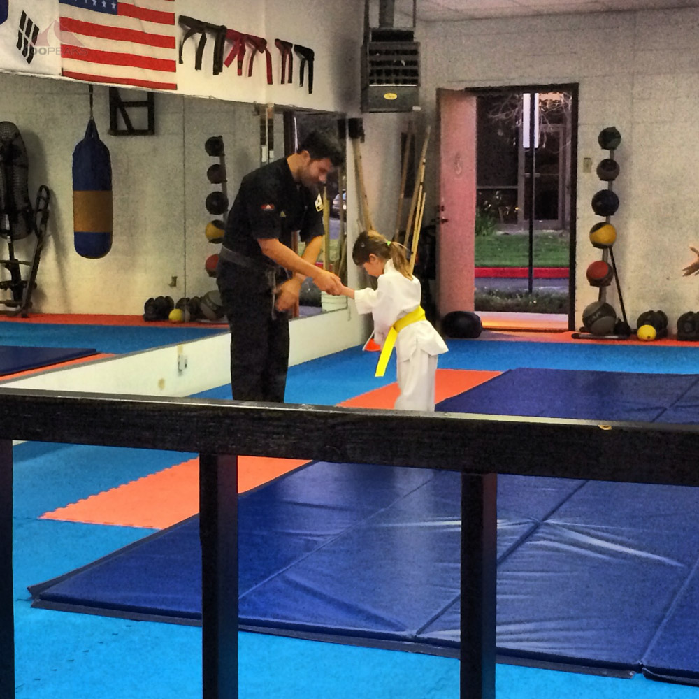 Soph, receiving her yellow belt in Tae Kwon Do