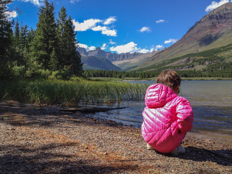 Soph on Swiftcurrent Lake with Iceberg Notch in the background at Glacier National Park
