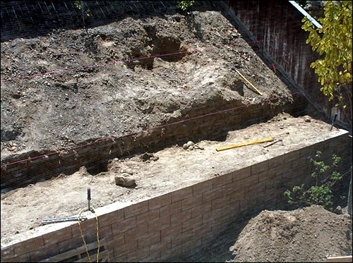 The retaining wall work began today