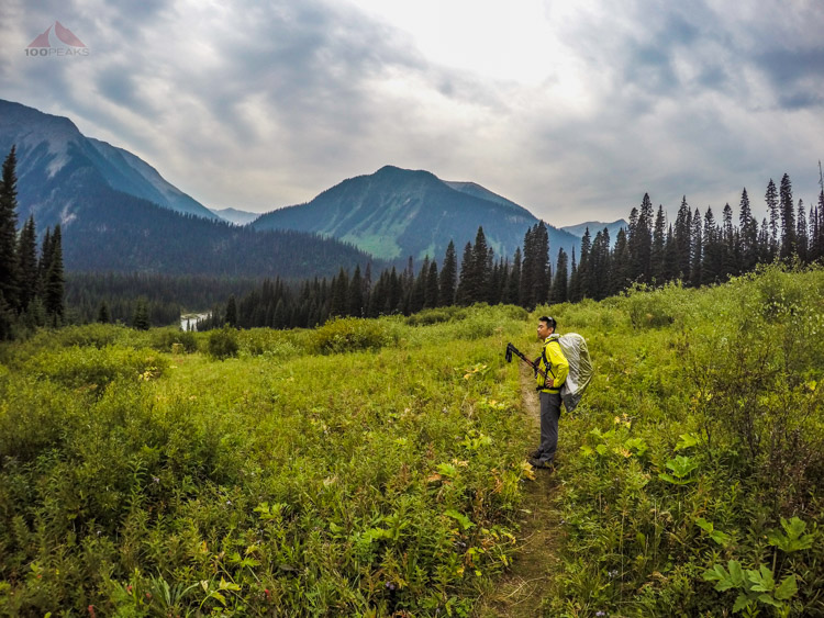 Crossing one of the several meadows on the Helmet Creek Trail, the rain has started