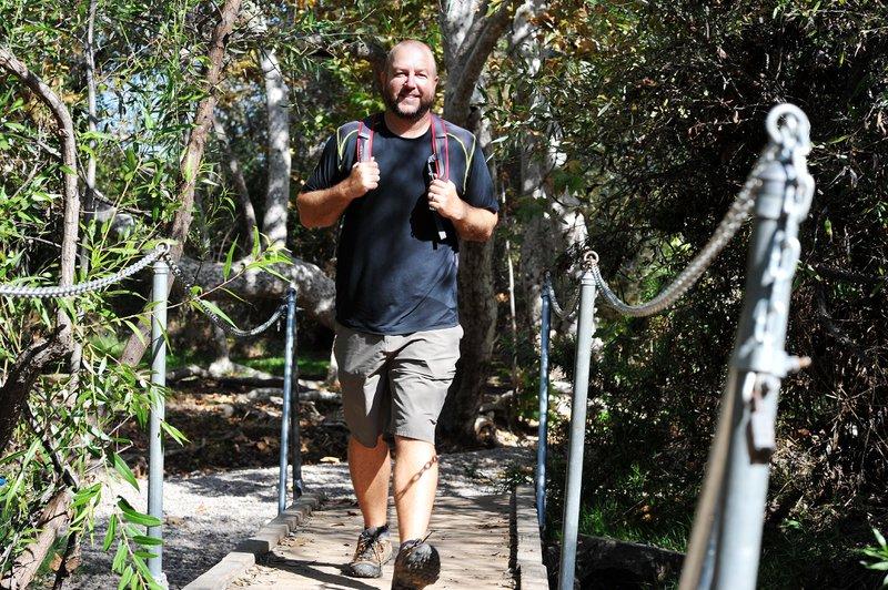 Me, strolling on a bridge - Photo by Rick Nocon