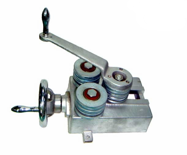 """SHV-BND-1N Came Bender   Designed to bend zinc, brass or copper channel. Strong aluminum frame screws onto a work bench. Bend """"U"""" channels as well as """"H"""" shapes, all on one set of rollers."""