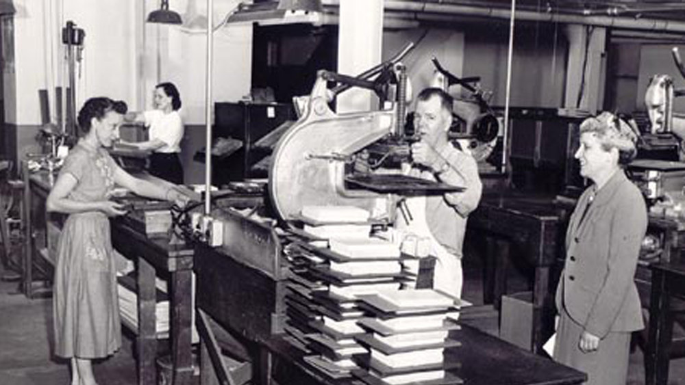 Hot foil stamping at the Hertzberg family book bindery, c. 1958