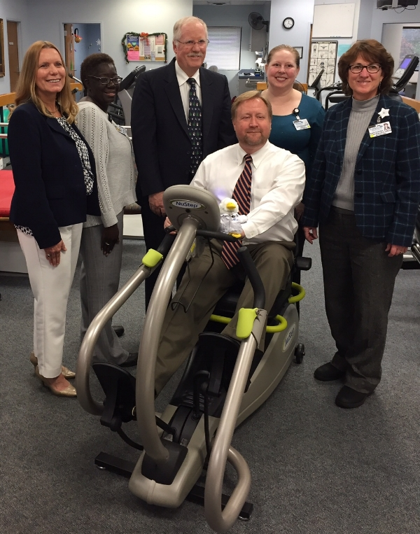 Pictured:  Rhonda Russell ( VP  AFLAC representative),  Fairfield County Administrator Jason Taylor demonstrates the NuStep equipment funded by AFLAC grant, Rhonda Russell (VP AFLAC representative),  Darlene Hines (COO of FMH), Mike Quinn (President of FMH Foundation), Sarah Stredney (Director of Rehabilitation at FMH) and Suzie Doscher (CEO of FMH).