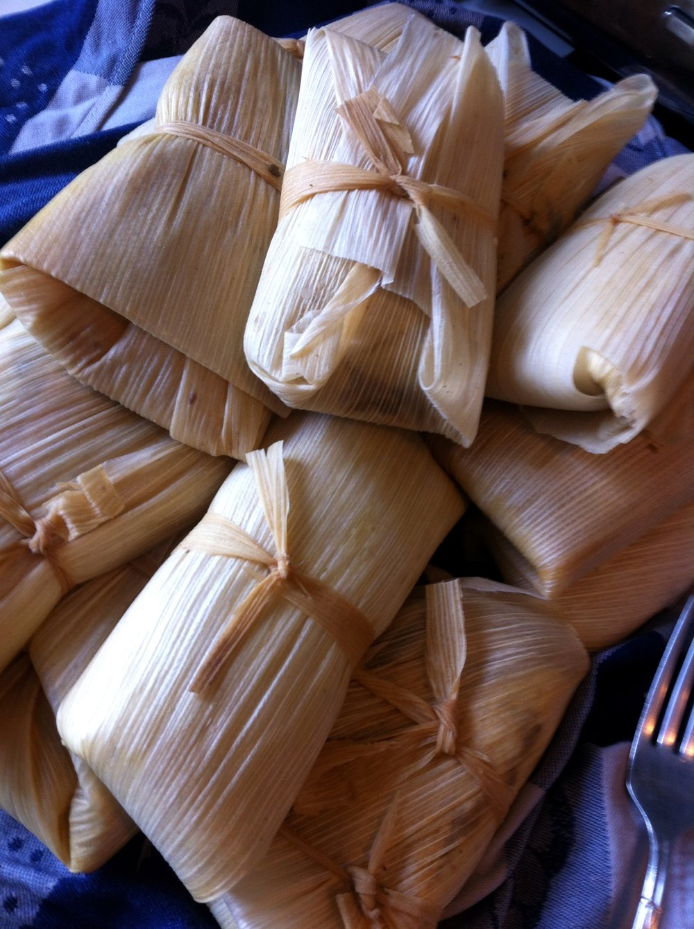 Peruvian tamales - corn husks filled with masa (corn dough) and chipotle vegetables