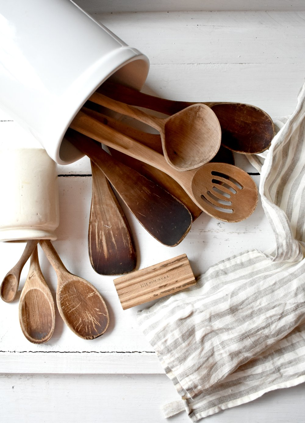 Wood utenils in a white crock