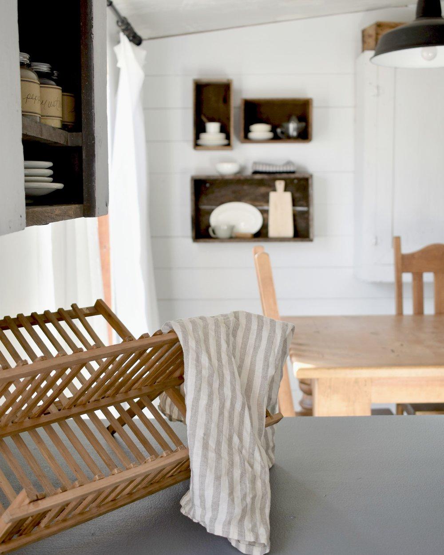 wood dish rack and linen towel