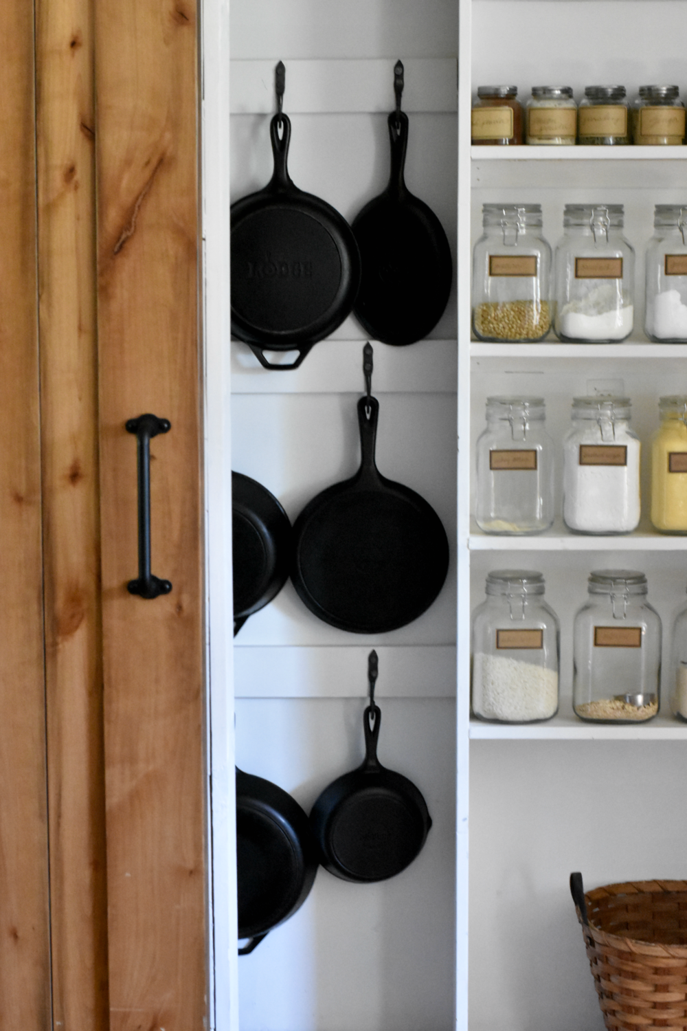 Hanging Cast Iron Skillets on Hooks in Farmhouse style Pantry