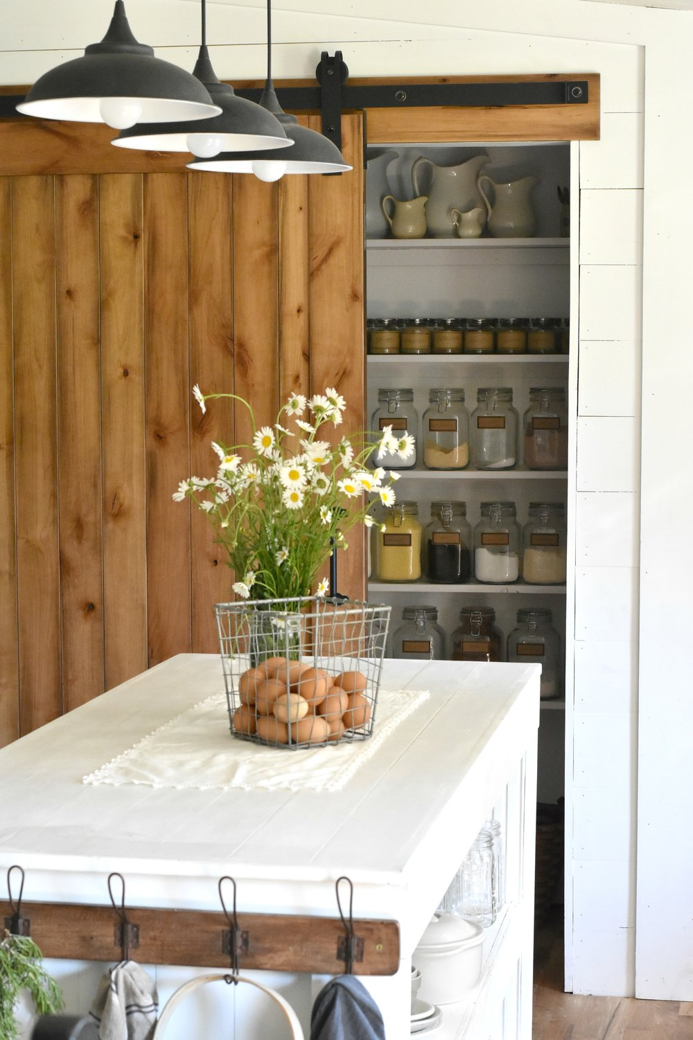 Rustica Hardware Sliding Barn Door Pantry in Farmhouse Kitchen