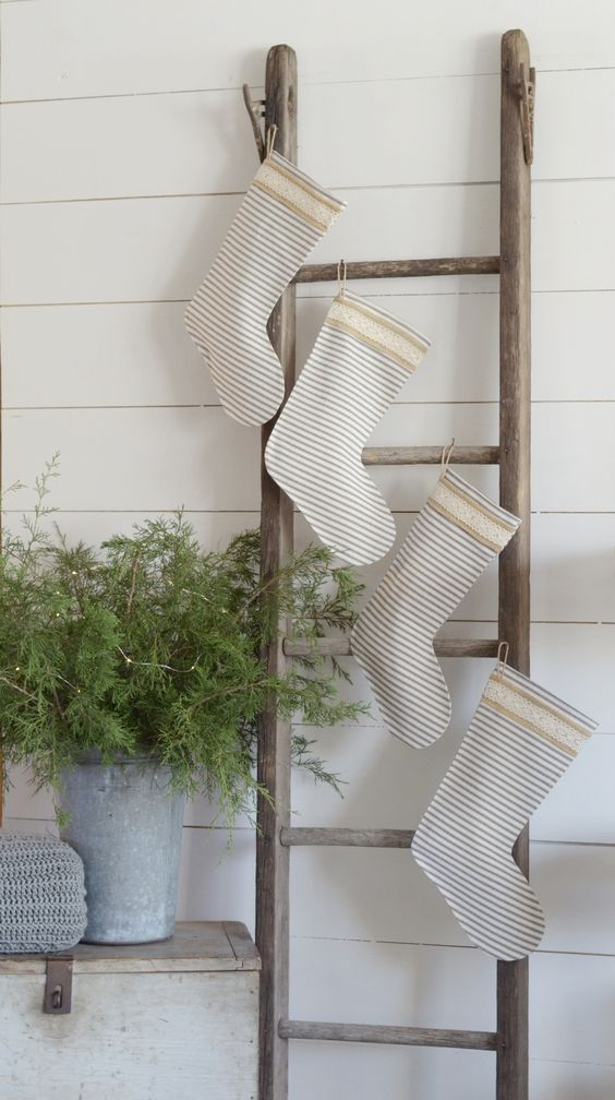 A Simple Farmhouse Christmas Tour - how to hang ticking stockings without a mantel